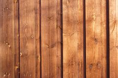Brown planks, painted wood stain. Seki and visible crack in the tree. Here and there you can see their heads of nails royalty free stock photos