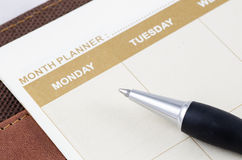 Brown planner book with pen Stock Photo
