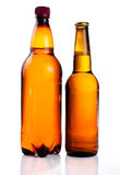 Brown plastic bottle and glass Stock Photos