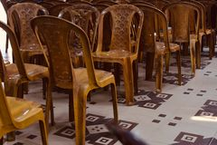 Brown plastic chairs in a room. Beautiful brown plastic chairs kept inside a room isolated unique photo stock images