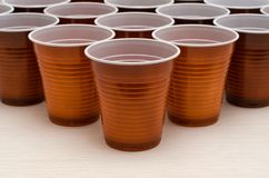 Brown plastic cups stock image