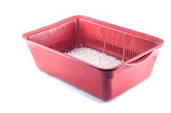 Brown plastic deep tray with silica gel litter for cat litter with white and pink granules on a white background, isolate.  stock photos