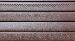 Brown plastic siding Stock Photography