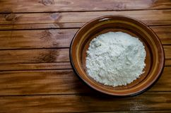 Small plate with flour on the table stock photography