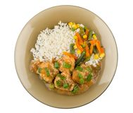 Brown plate with meatballs, rice, vegetable mix isolated on whit Stock Image