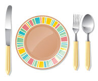 Brown plate, steel spoon, fork, knife Stock Photography