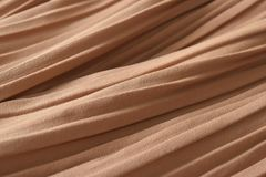 Brown pleat fabric background is a beautiful curved wave. Royalty Free Stock Photography