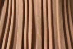 Brown pleat fabric background is a beautiful curved wave. Royalty Free Stock Image