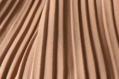 Brown pleat fabric background is a beautiful curved wave. Stock Image