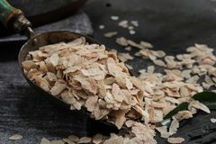 Brown Poha or Aval / flattened Rice flakes in a metal scoop, selective focus. Brown Poha or Aval / flattened Rice flakes in a metal scoop Royalty Free Stock Photo