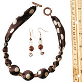 Brown polka dot silk beads and earrings Stock Photography