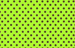 Brown polka dot with yellow green background Stock Photos