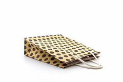 Brown polka dots paper bag. stock images