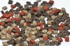 Brown Polymer resin. Several brown coloured polymer resin (granulates Stock Photos