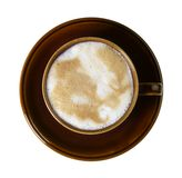 Brown porcelain cup with marbled milk froth Stock Photography