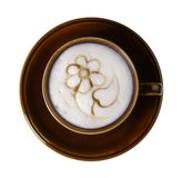 Brown porcelain cup with marbled milk froth Royalty Free Stock Image