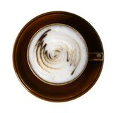 Brown porcelain cup with marbled milk froth Royalty Free Stock Photography