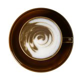 Brown porcelain cup with marbled milk froth Royalty Free Stock Photos