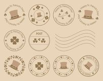 Brown postal stamps with clovers and hat for saint patrick day Stock Photos