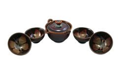 Brown pot and four bowls with butterfly drawing Royalty Free Stock Images