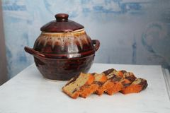 Brown pot with honey. Clay pot with sweet flower honey with peace of white stock image