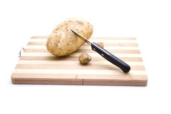 Brown Potato with Knife Royalty Free Stock Images
