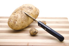 Brown Potato with Knife Royalty Free Stock Photo