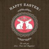 Brown powitań karta dla Wielkanocnego dnia z dwa królikami Zdjęcia Royalty Free