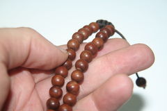 Brown prayer beads. Details of buddhist prayer beads royalty free stock photo