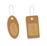 Brown price tags with an inscription sale. On  white background Royalty Free Stock Images