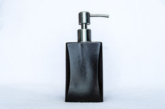 A brown pumping bottle. On white background Stock Photos
