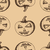 Brown pumpkins on a beige background Royalty Free Stock Photos