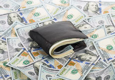 Brown purse full of money Stock Images