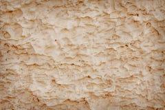 Brown que emplastra a textura do muro de cimento em testes padrões ásperos sem emenda para o fundo fotografia de stock