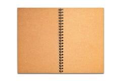 Brown réutilisent ouvert blanc de papier de cahier d'isolement Photographie stock libre de droits