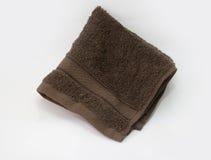 Brown ręcznik, kąpielowy ręcznik odizolowywający na bielu Obraz Stock