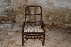 Brown chair in the old cellar Stock Photos