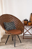 Brown rattan Chair in interior setting Royalty Free Stock Photography