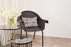 Brown rattan Chair in interior setting Stock Photos