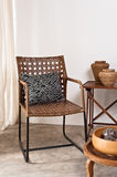 Brown rattan Chair in interior setting Stock Photo