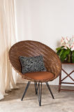 Brown rattan Chair in interior setting Royalty Free Stock Image