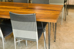 brown rattan chair and wooden table Stock Images