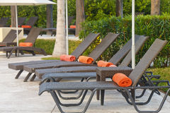 Brown Rattan Chaise Chairs with Orange Towels Stock Photos