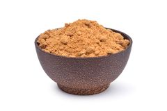 Brown raw cane sugar in wooden bowl Royalty Free Stock Image