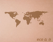 Brown recicl o papel com mundo do mapa Foto de Stock Royalty Free
