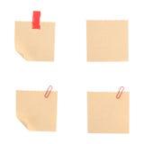 4 Brown reciclam as notas com grampo e o escocês isolados no branco Imagens de Stock Royalty Free