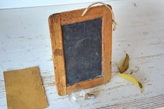Brown Rectangular Wooden Picture Frame Near Light Bulb Stock Photos