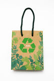 Brown recycle paper. Shopping bag crumpled with green recycle symbol on white background Stock Photography