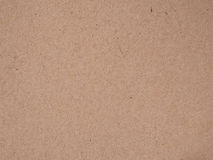 Brown recycled old paper texture or brown craft carton old rough plain light cardboard background.  stock image