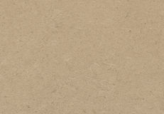 Brown recycled paper texture. Dark brown recycled paper texture with copy space royalty free stock photos